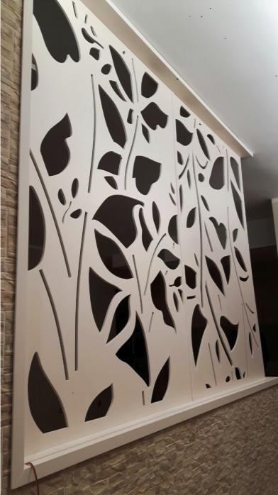 Porte interne artigianali in legno traforato